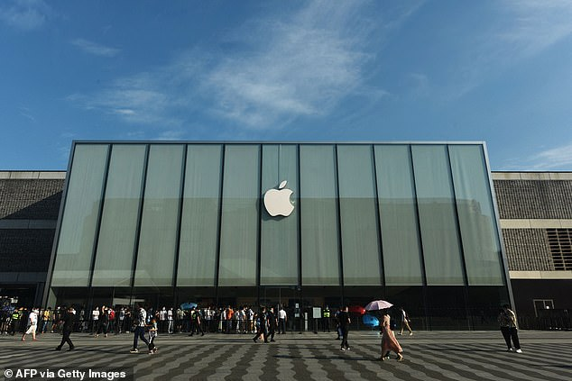 Customers queue to get newly-launched iPhone 13 mobile phones at an Apple store in Hangzhou