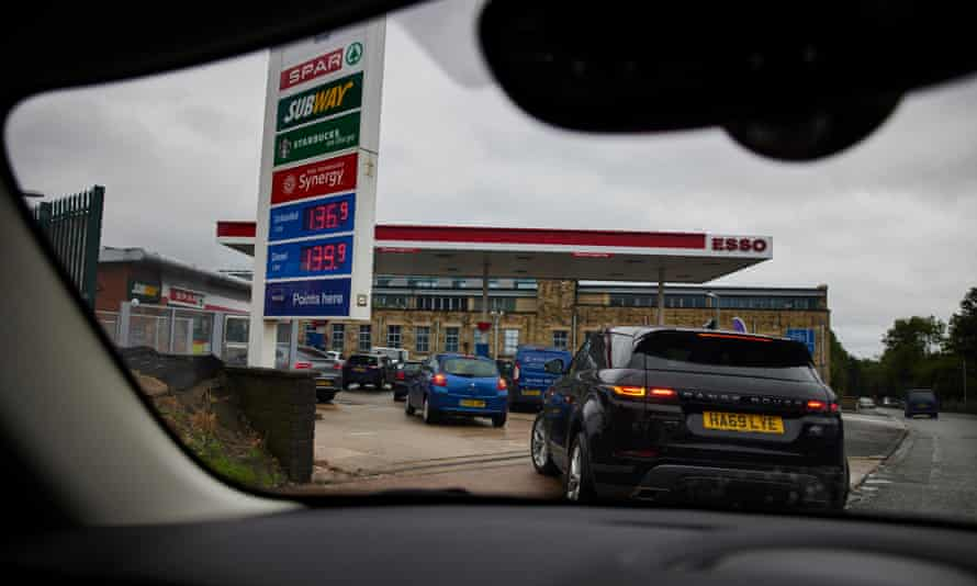 Motorists queueing for fuel in Greater Manchester.