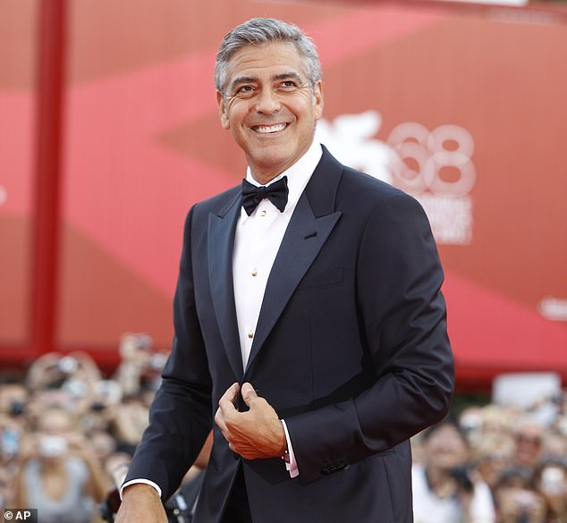 Messing around: Clooney and Pitt have been involved in a good-natured prank war for several years; the former is pictured in 2011
