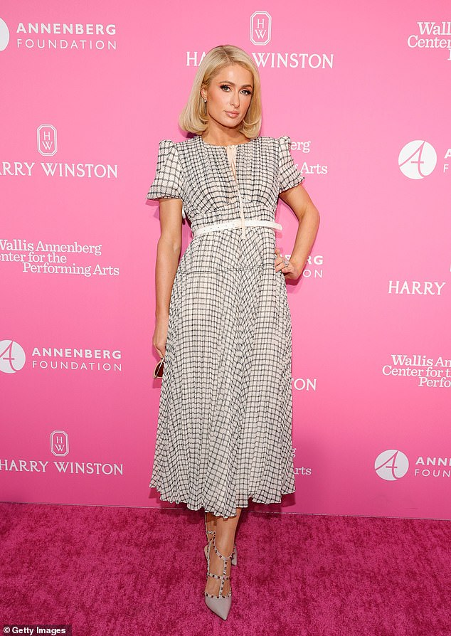 On the mark: Paris showed off some of her classic elegance in an off-white windowpane plaid dress as she hit the red carpet