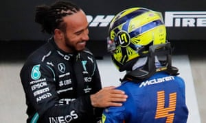 Lewis Hamilton is congratulated by Lando Norris who finished P7 .