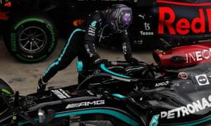 Mercedes' Lewis Hamilton celebrates after winning the race.