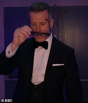Loving it! The Strictly stalwart put on a pair of sunglasses while clad in a sleek tux