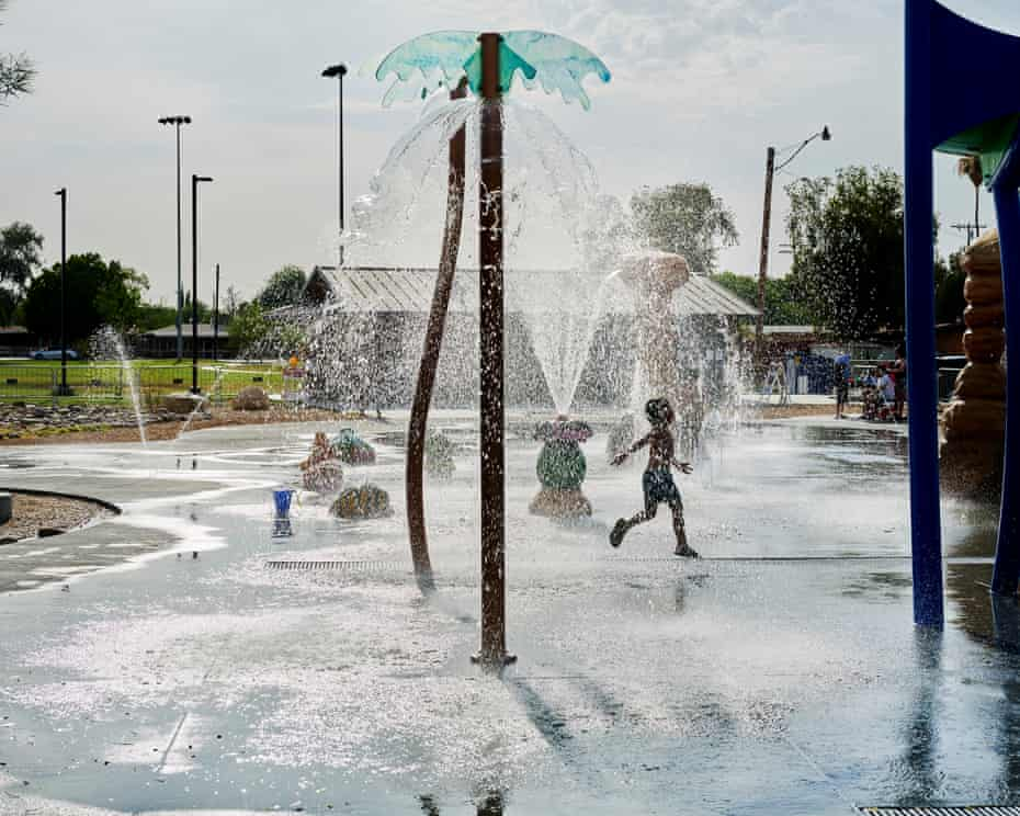 Children play in a water park on a hot June afternoon where temperatures reached 110 degrees, in Brawley.