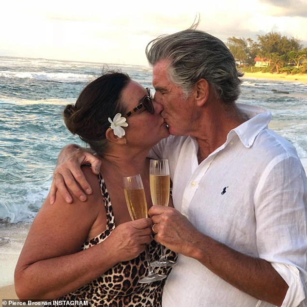 SMOOCH:They wed in 2001 and have two children together - sons Dylan, 24, and Paris, 20