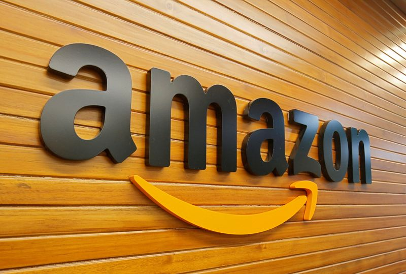 Amazon boosts hourly pay to over $18, to hire 125,000 workers