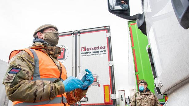 British Army soldiers delivering Covid-19 tests to a lorry drivers on the M20 in Kent