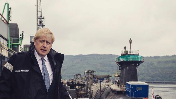Boris Johnson posts images to Instagram of him visiting a submarine in Scotland.