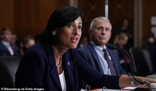 CDC Director Rochelle Walensky reversed her own agency's advisory panel in a rare move late Thursday and added a recommendation for boosters for people at risk because of their jobs. Pictured: Walenskyspeaks during a Senate committee hearing, July 2021
