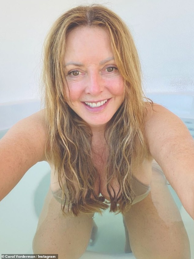 Woah!Carol Vorderman, 60, sent temperatures soaring as she showed off her ample assets in a busty nude bikini for a steamy hot tub Instagram selfie on Tuesday