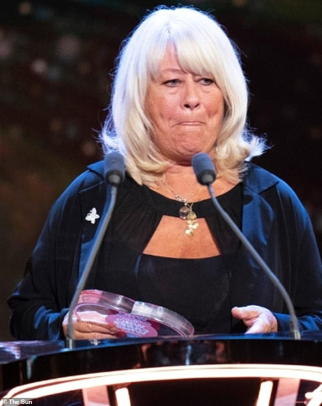 Heartbreaking:Caroline Flack's mother Christine took to the stage at The Sun's Who Cares Wins awards on Sunday night to tearfully present a mental health honour in her late daughter's name