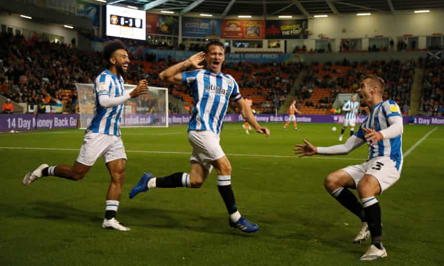 Jonathan Hogg celebrates after scoring Huddersfield's third at Bloomfield Road.