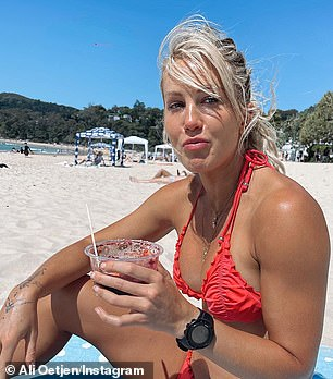 Lookalikes: Former Bachelorette Ali Oetjen (pictured) stripped down to a skimpy bikini as she hit the beach with her lookalike brother in Noosa on Monday