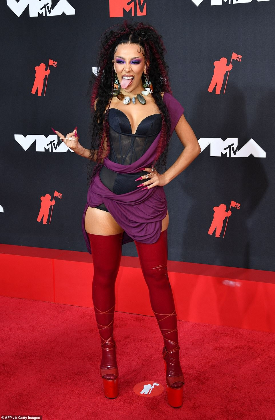 Girl power:Doja Cat - who was hosting the evening's affair - was the star of the evening, strutting down the red carpet wearing a toga-inspired look with a black bustier and drapey plum fabric