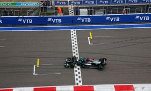 Mercedes' Lewis Hamilton crosses the line to win the race.