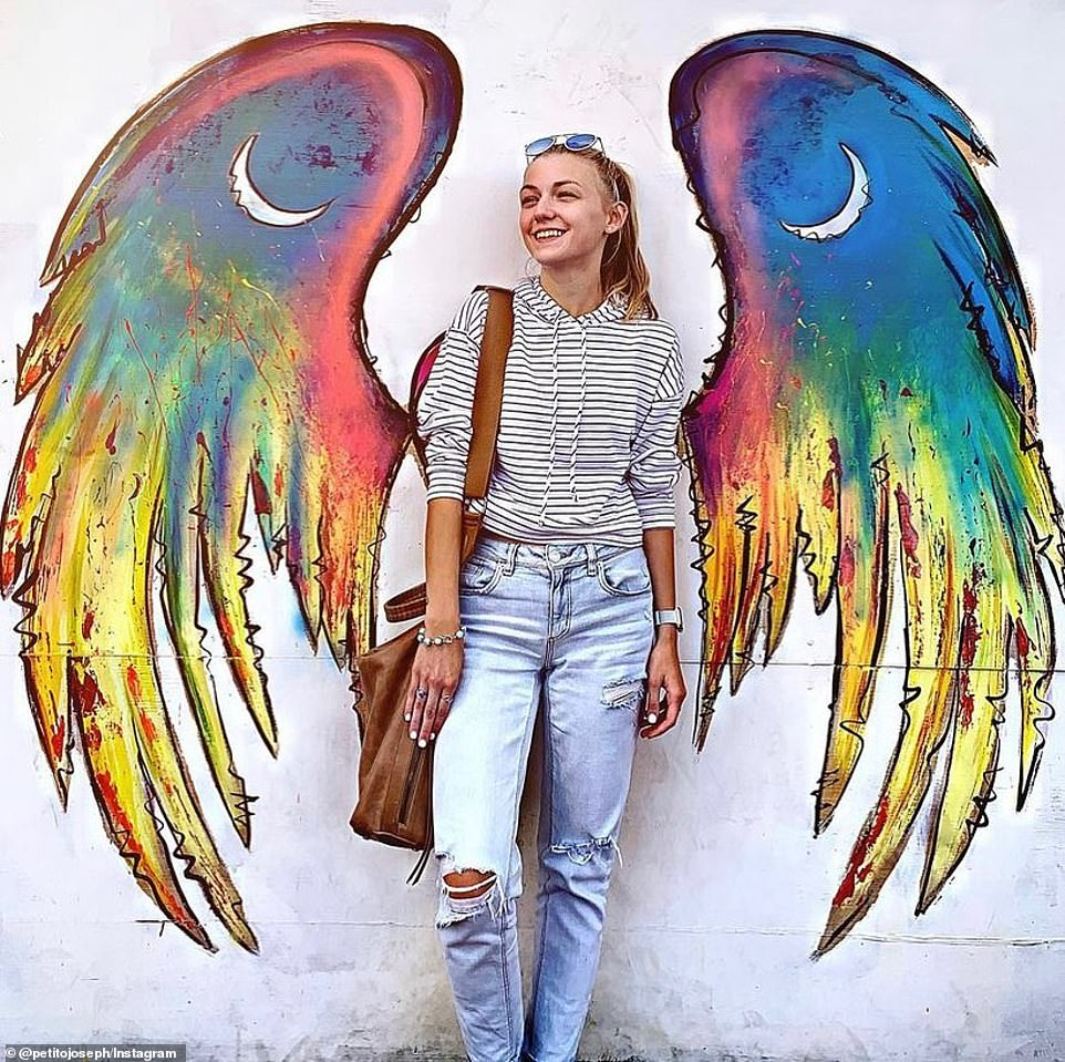 Missing van-life girl Gabby Petito's father, Joseph, shared a tribute to his daughter on social media Sunday with a photo of her adorned with angel wings (pictured) and the caption: 'she touched the world' as authorities confirmed that remains matching her description had been found in Wyoming