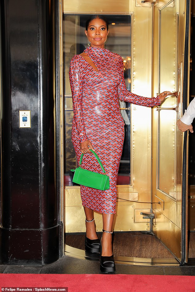 Chic: Flawless co-founder Gabrielle Union emerged from The Carlyle in Manhattan's Upper East Side on Tuesday looking gorgeous in a patterned PVC pencil dress, black platforms, and a green bag
