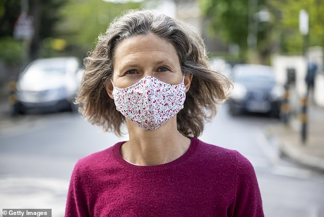 Cloth masks are effective at stopping coronavirus particles from spreading if they meet certain criteria, a new study suggests (file image)