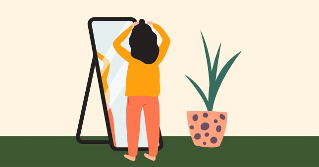 woman standing in mirror
