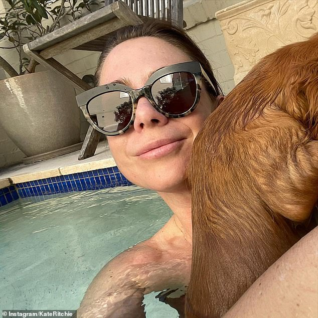 Something to howl about:Kate Ritchie [pictured] was the definition of chic as she took her pampered puppy for its first swim on Sunday, sharing the image to Instagram