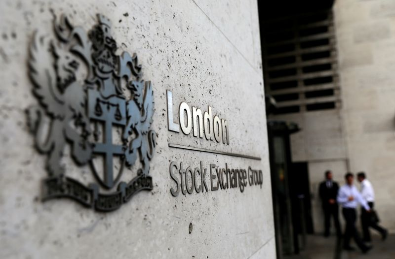 Melrose, healthcare stocks lift FTSE 100; ex-dividend trades cap gains