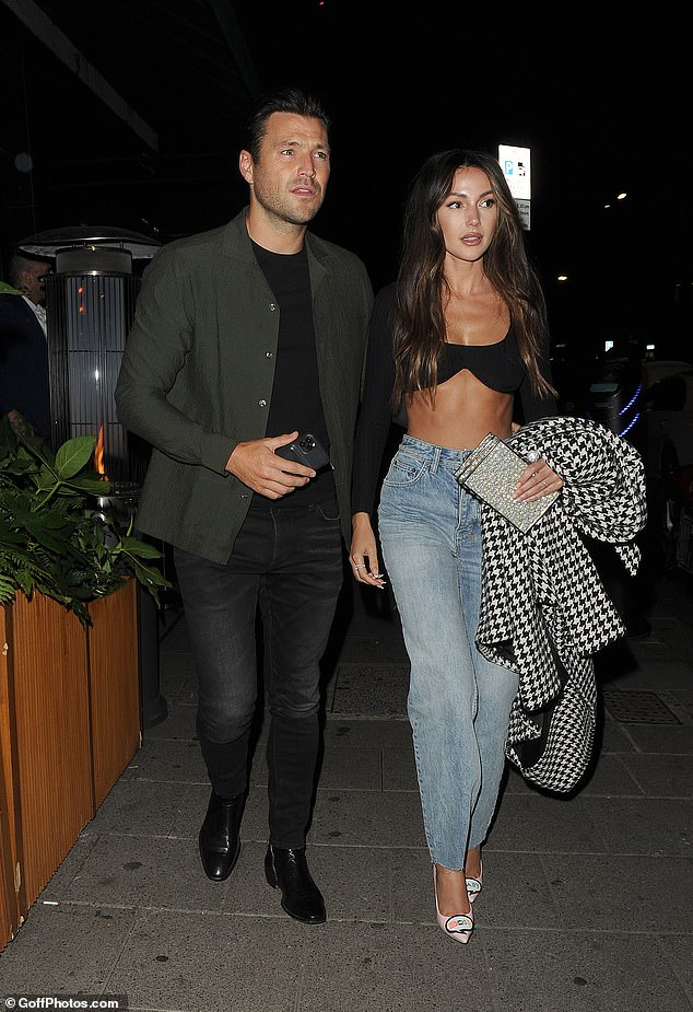 Wow!Michelle Keegan flashed her incredible abs in a tiny black crop top as she stepped out for a date night with her husband Mark Wright at Amazonia restaurant in Mayfair, London on Friday