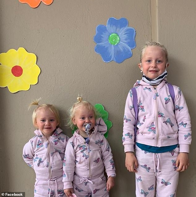 South African doctorLauren Dickason, 40, has been charged with the murder of her two-year-old twins, Maya and Karla, and their six-year-old sister Liane (pictured together)