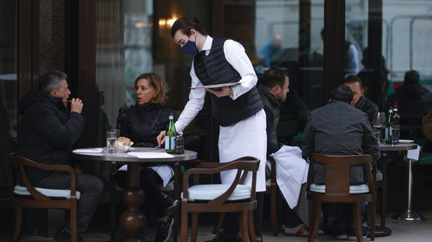 A waiter in London's Covent Garden. Tory ministers have promised tipping reforms for years