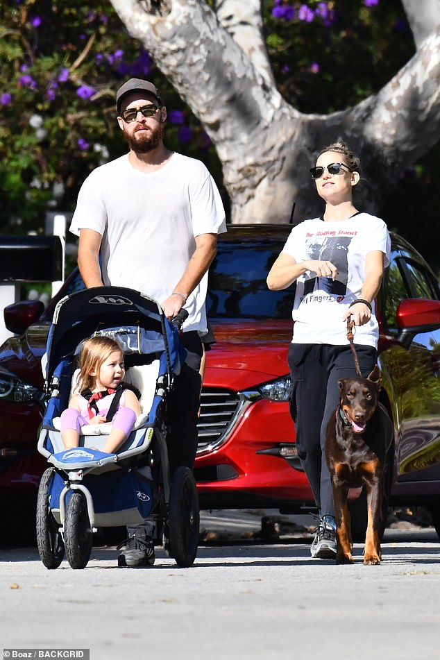 Family time:Kate Hudson looked blissful as she strolled with fiance Danny Fujikawa and their two-year-old daughter Rani on Thursday afternoon in Brentwood, California