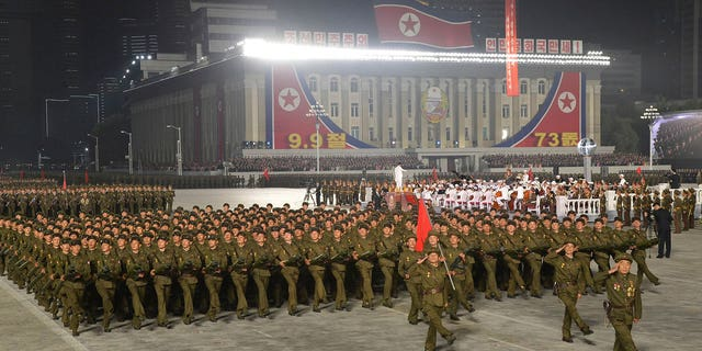 """In this photo provided by the North Korean government, North Korean soldiers parade during a celebration of the nation's 73rd anniversary that was overseen by leader Kim Jong Un, at Kim Il Sung Square in Pyongyang, North Korea, early Thursday, Sept. 9, 2021. Independent journalists were not given access to cover the event depicted in this image distributed by the North Korean government. The content of this image is as provided and cannot be independently verified. Korean language watermark on image as provided by source reads: """"KCNA"""" which is the abbreviation for Korean Central News Agency. (Korean Central News Agency/Korea News Service via AP)"""