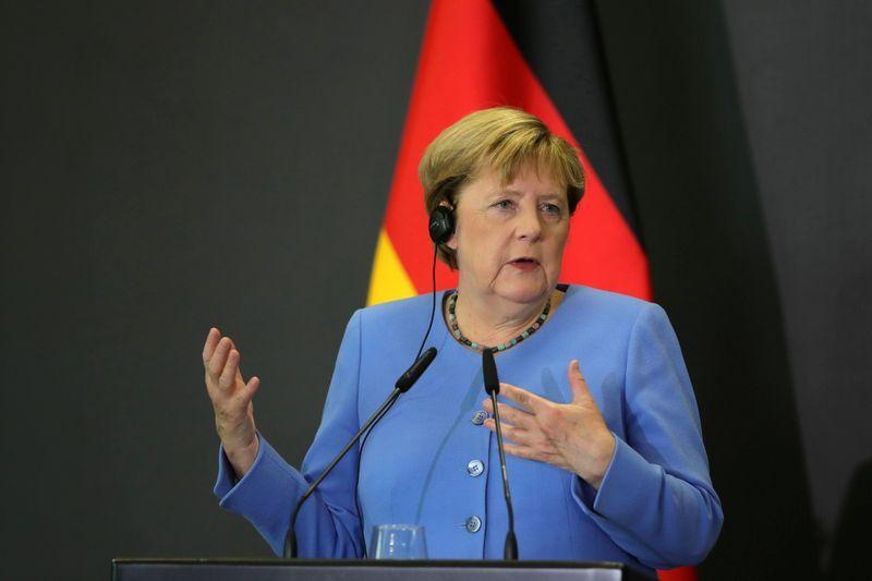 Not gone yet: Merkel to hang on as active caretaker