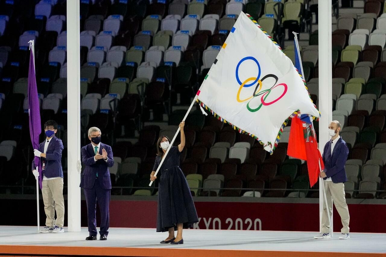 International Olympic Committee President Thomas Bach gives the Olympic flag to Paris Mayor Anne Hidalgo during the closing ceremony in the Olympic Stadium at the 2020 Summer Olympics, on August 8, 2021, in Tokyo, Japan
