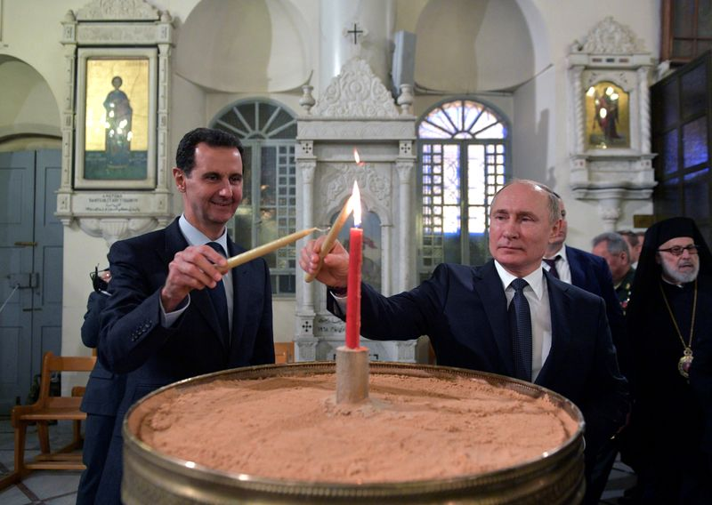 Putin criticises foreign forces in Syria at Kremlin meet with Assad