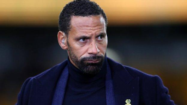 Rio Ferdinand with a television earpiece in