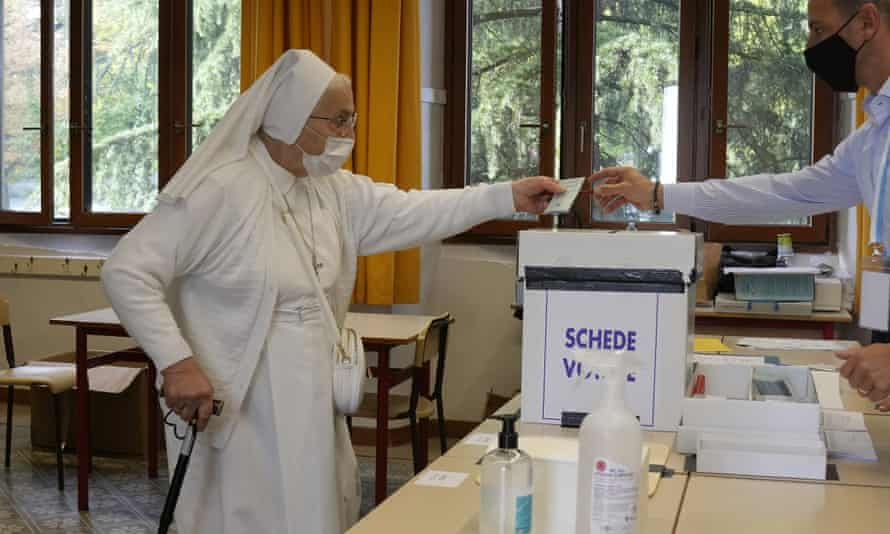 A nun casts her ballot for the abortion referendum at a polling station in San Marino