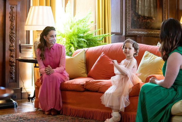 Mila Sneddon meets the Duchess of Cambridge at the Palace of Holyrood in Edinburgh
