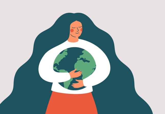 Young woman embraces green planet Earth with care and love.
