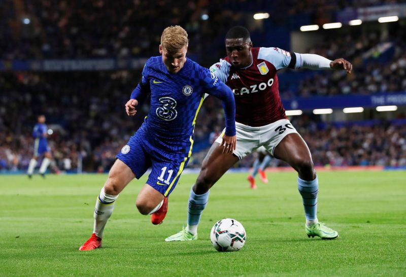 Soccer-Chelsea edge past Villa on penalties, Man Utd out of League Cup