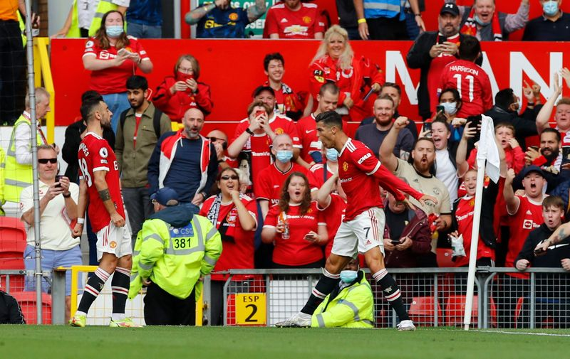 Soccer-Ronaldo debut double as Man United overwhelm Newcastle