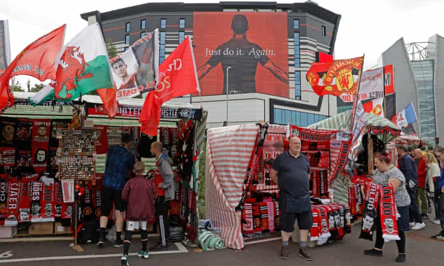 Merchandise sellers outside Old Trafford on Saturday.