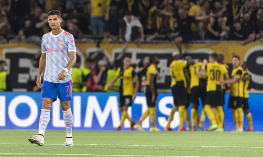 Cristiano Ronaldo looks dejected as Young Boys celebrate scoring against Manchester United