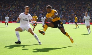 Adama Traore takes on the Bee's defence.