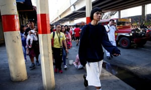 Oliver Emocling, 23, who works for a magazine, walks to the train station in Caloocan City