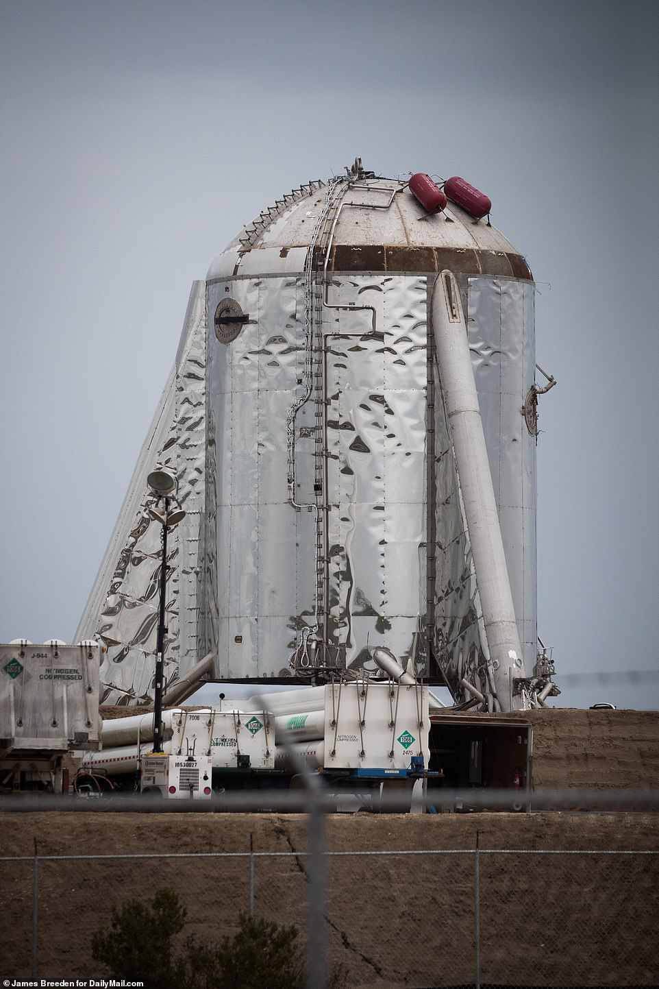 Elon Musk said SpaceX chose to omit a nosecone from the Starhopper prototype (pictured Wednesday) after it was toppled off of the spacecraft as a result of strong wind gusts earlier this year