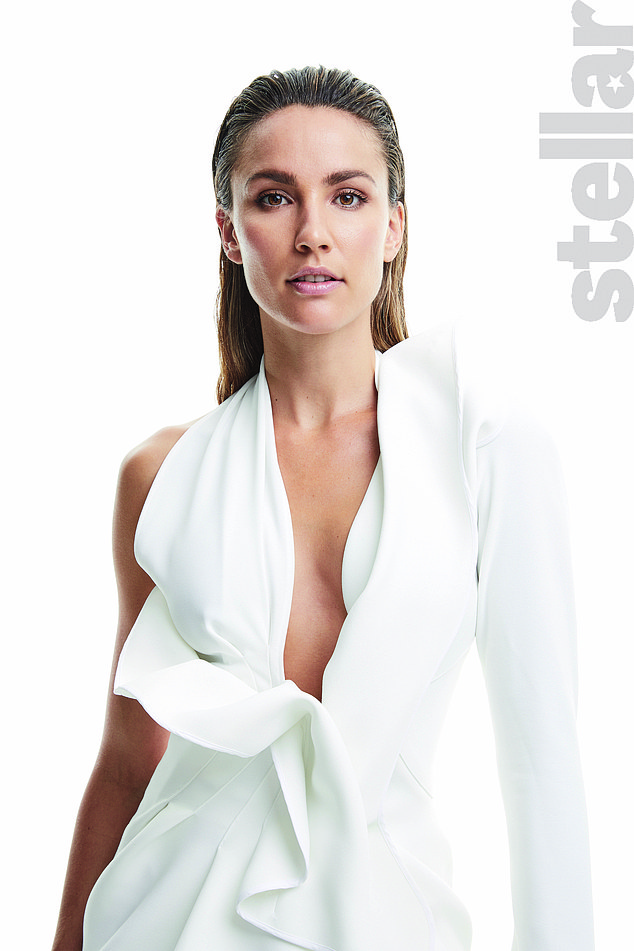 Elegant:In one outfit, the mother-of-two slicked her hair back and revealed a hint of cleavage in a white dress
