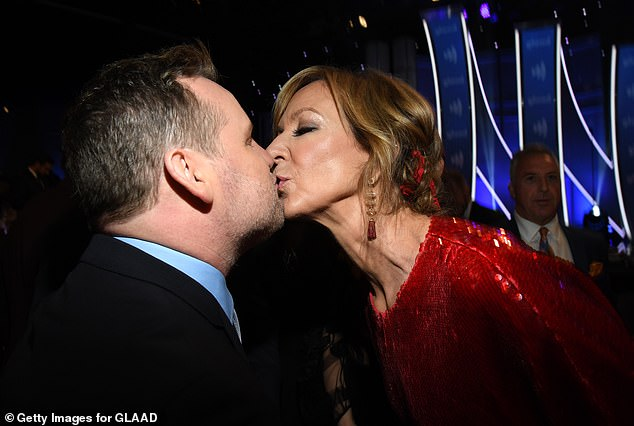 Pucker up:However, Allison also shared the love with Sean's husband Scott Icenogle, planting a kiss on his lips