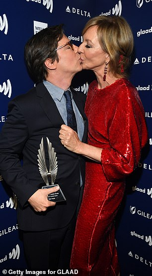 Kiss kiss: Allison cosied up to pal Sean Hayes on the red carpet, with the two locking lips