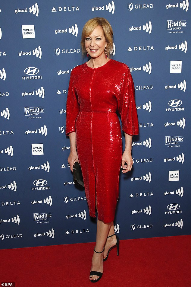 Dazzling:The actress oozed sophistication in the sequinned ruby number which featured a daring split at the front
