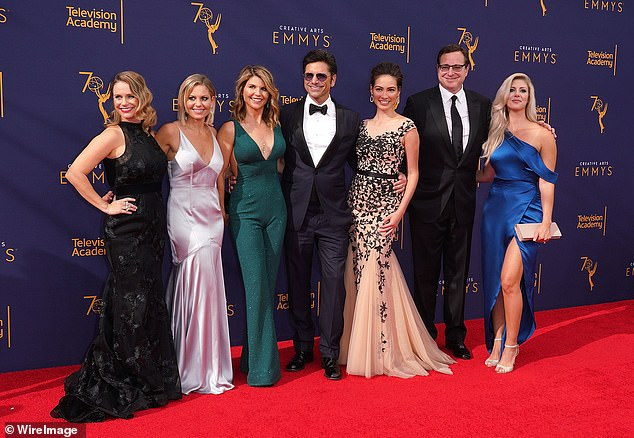 Are they calling her? Here she is seen with (L-R) Andrea Barber, Candace Cameron Bure, John Stamos, Caitlin McHugh, Bob Saget, and Kelly Rizzo in September in Los Angeles