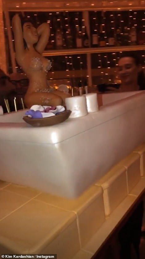 A front angle of the very detailed cake saw Kourtney's edible body covered in soap suds